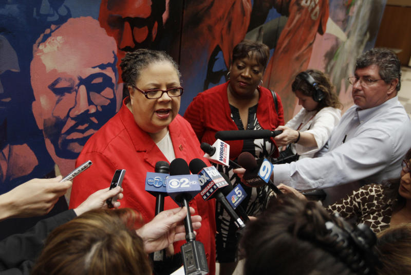 Chicago Teachers Union President Karen Lewis speaks to the news media after casting her ballot during a strike authorization vote at a Chicago high school Wednesday, June 6, 2012. Lewis says union members don't want to disrupt the start of the next school year with a strike, but she says they feel voting to authorize one is needed to negotiate a better contract. (AP Photo/M. Spencer Green)