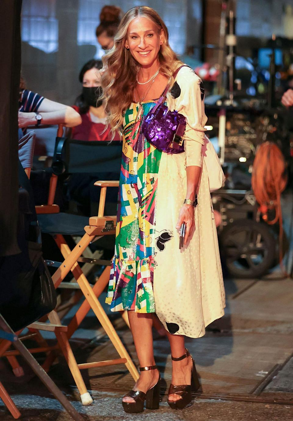 <p>Sarah Jessica Parker gets into character on the set of her <em>Sex and the City </em>revival <em>And Just Like That...</em> in New York City.</p>