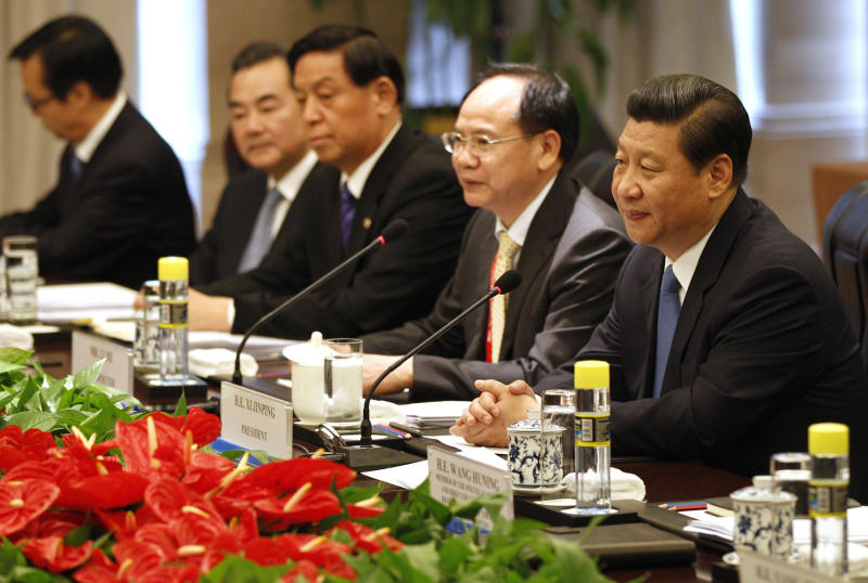 China's President Xi Jinping, right, listens during a meeting with Cambodian Prime Minister Hun Sen, unseen, in Boao town, Hainan province, China, Sunday, April 7, 2013. (AP Photo/Tyrone Siu, Pool)