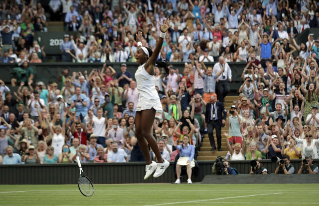 """FILE - In this Friday, July 5, 2019, file photo, United States' Cori """"Coco"""" Gauff celebrates after beating Slovenia's Polona Hercog in a women's singles match during day five of the Wimbledon Tennis Championships in London. (AP Photo/Ben Curtis, File)"""