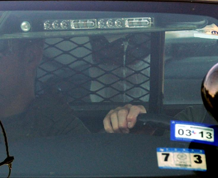 Naser Jason Abdo, riding in a federal vehicle and wearing a facial mask, arrives at the U.S. Federal Courthouse in Waco, Texas Friday, Aug. 10, 2012. Abdo was convicted of planning a massive attack on a restaurant full of Fort Hood soldiers as part of a religious mission. (AP Photo/Waco Tribune-Herald, Rod Aydelotte)