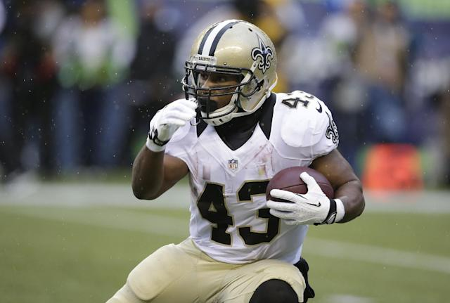 FILE - In this Jan. 11, 2014, file photo, New Orleans Saints running back Darren Sproles runs against the Seattle Seahawks during an NFC divisional playoff NFL football game in Seattle. The Philadelphia Eagles were eager to let the world know about the addition of the 30-year-old Sproles, who figures to be a threat as a receiver, runner, returner and in pass protection against blitzers. (AP Photo/Elaine Thompson, File)