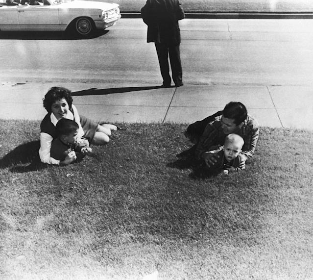 <p>Spectators drop to the ground after shots are fired at Dealy Plaza during the assassination of President Kennedy in Dallas, Texas on Nov.22, 1963. (Photo: Corbis via Getty Images) </p>