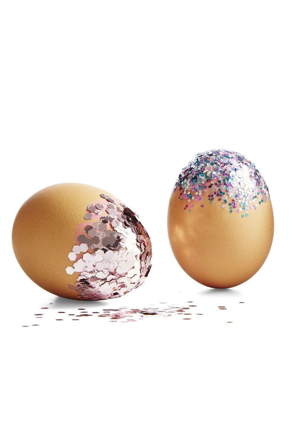 """<p>Glitter makes everything better, doesn't it? Make your Easter extra sparkly this year with these colorful glitter eggs. </p><p><strong><em>Get the tutorial at <a href=""""https://www.goodhousekeeping.com/holidays/easter-ideas/g711/easter-spring-crafts/?slide=26"""" rel=""""nofollow noopener"""" target=""""_blank"""" data-ylk=""""slk:Good Housekeeping."""" class=""""link rapid-noclick-resp"""">Good Housekeeping. </a></em></strong></p>"""