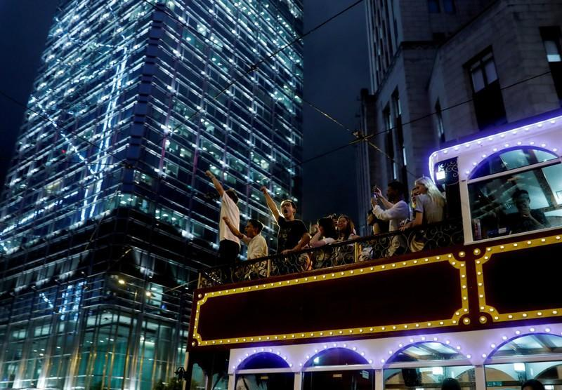 FILE PHOTO: Passengers on the tram shout slogans as it passes a rally by civil servants to support the anti-extradition bill protest in Hong Kong