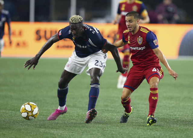 New England Revolution midfielder Wilfried Zahibo (23) and Real Salt Lake midfielder Justin Portillo (43) battle for the ball during the second half of an MLS soccer match at Gillette Stadium, Saturday, Sept. 21, 2019, in Foxborough, Mass. (AP Photo/Stew Milne)