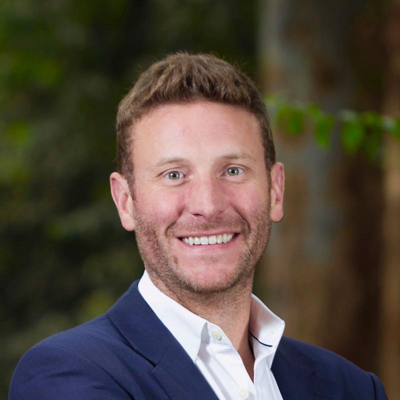 This undated photo provided by I-DEV international shows Jason Spindler in Nairobi, Kenya. DEV International confirmed that Spindler, the company's co-founder and managing director, was killed Tuesday, Jan. 15, 2019, when gunmen staged a deadly attack on a luxury hotel and shopping complex in Nairobi.