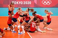 <p>Team USA's women's volleyball team reacts after defeating Team Brazil during the Women's Gold Medal Match, winning their very first gold medal. </p>