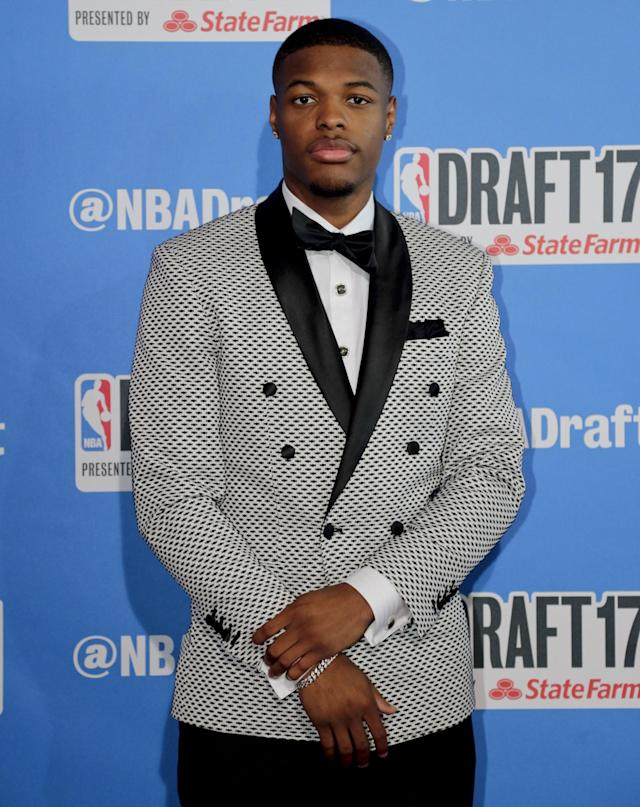 <p>North Carolina State's Dennis Smith poses for photos while walking the red carpet before the start of the NBA basketball draft, Thursday, June 22, 2017, in New York. (AP Photo/Frank Franklin II) </p>