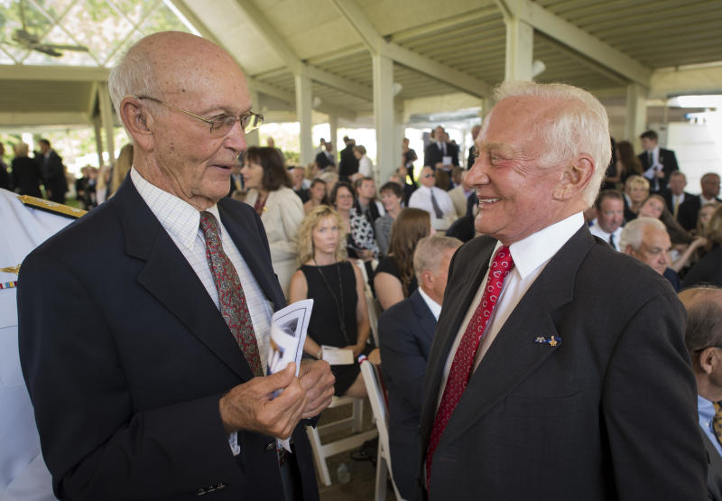"""Apollo 11 astronauts Michael Collins, left, and Edwin """"Buzz"""" Aldrin, talk at a private memorial service celebrating the life of Neil Armstrong, Friday, Aug. 31, 2012, at the Camargo Club in Cincinnati. A national memorial service has been scheduled for Sept. 12 in Washington. Armstrong, the first man to walk on the moon during the 1969 Apollo 11 mission, died Saturday, Aug. 25. He was 82. (AP Photo/NASA, Bill Ingalls)"""