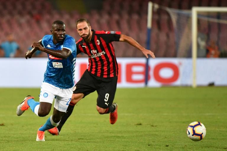 Senegalese defender Kalidou Koulibaly helped stifle Argentine forward Gonzalo Higuain as Napoli fought back to beat Milan