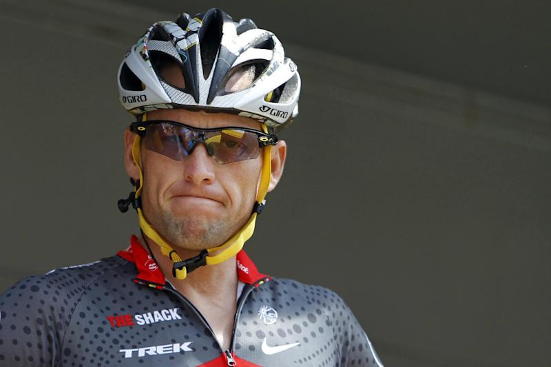 FILE - In this July 6, 2010, file photo, Lance Armstrong grimaces prior to the start of the third stage of the Tour de France cycling race in Wanze, Belgium. Armstrong said on Thursday, Aug. 23, 2012, that he is finished fighting charges from the United States Anti-Doping Agency that he used performance-enhancing drugs during his unprecedented cycling career, a decision that could put his string of seven Tour de France titles in jeopardy. (AP Photo/Christophe Ena, File)