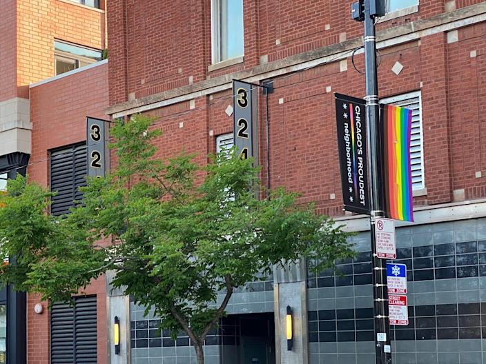 a street in boystown chicago with rainbow flags