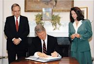 <p>Pelosi looks on as President Bill Clinton signs an executive order. </p>