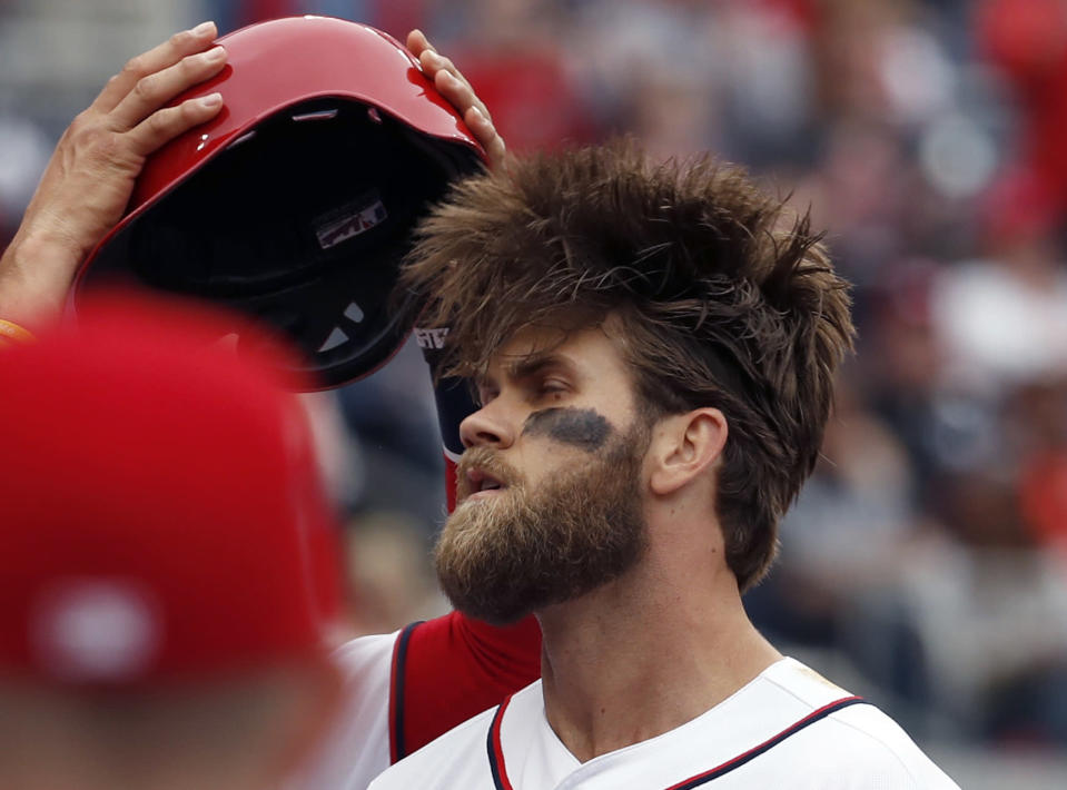 Bryce Harper decided to change things up with his hairdo. (AP Photo)