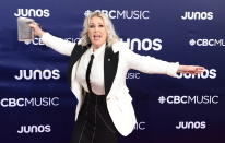 <p>The iconic Canadian rocked the red carpet in a chic black and white blazer. </p>