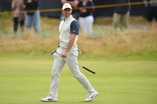Kisner leads British Open as McIlroy, Woods prepare to begin charge