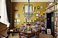 "<p>This art-filled library swathed in a <a href=""https://www.veranda.com/home-decorators/advice-from-designers/g34730566/gold-paint-colors/"" rel=""nofollow noopener"" target=""_blank"" data-ylk=""slk:golden yellow paint color"" class=""link rapid-noclick-resp"">golden yellow paint color</a> is evocative of many of our favorite designers across the pond. Ample book storage, plenty of wall (and floor!) space to display art, and a whimsical chandelier make this office space feel both academic and creative to stimulate both the right and left brain.</p>"