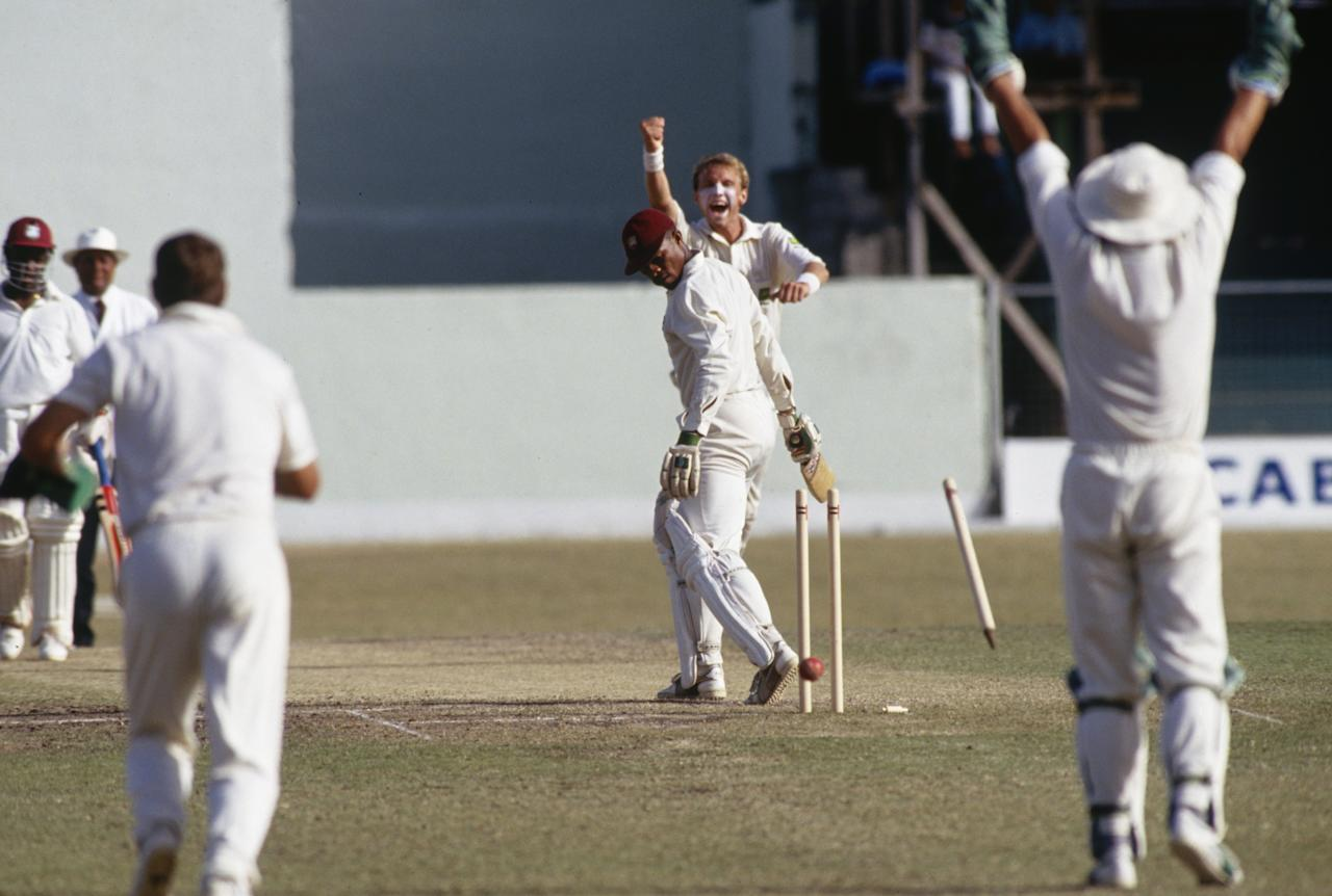 Keith Arthurton of the West Indies is bowled by Allan Donald of South Africa on the third day of the historic first Test in Barbados, 21st April 1992. (Photo by Shaun Botterill/Getty Images)
