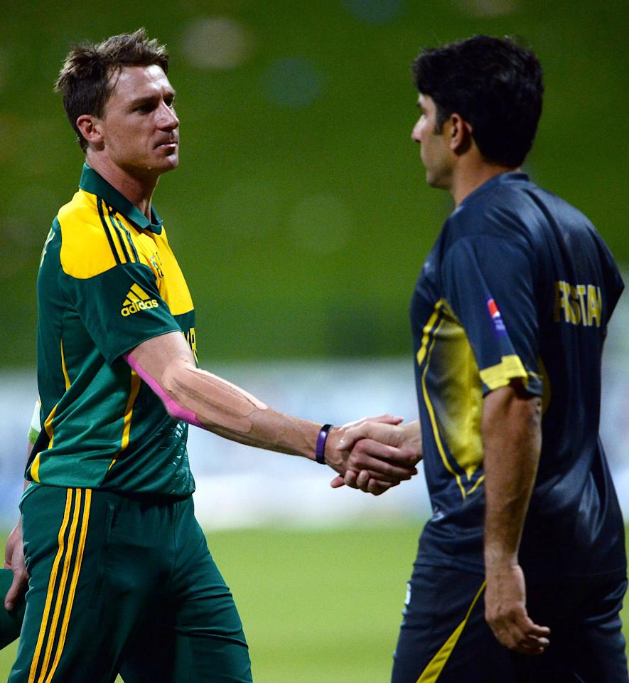 South African bowler Dale Steyn (L) shakes hands with Pakistan's cricket captain Misbah-ul Haq (R) after finishing the third day-night international in Sheikh Zayed Cricket Stadium in Abu Dhabi on Novemver 6, 2013. South Africa produced a clincal performance to beat Pakistan by 68 runs in the third day-night international and take a 2-1 lead in the five-match series. AFP PHOTO/ Asif HASSAN        (Photo credit should read ASIF HASSAN/AFP/Getty Images)