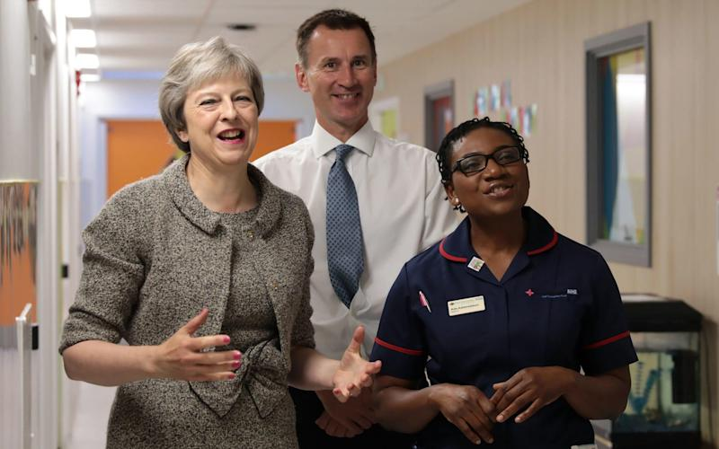 Theresa May and Jeremy Hunt meet a nurse at the Royal Free hospital today - PA