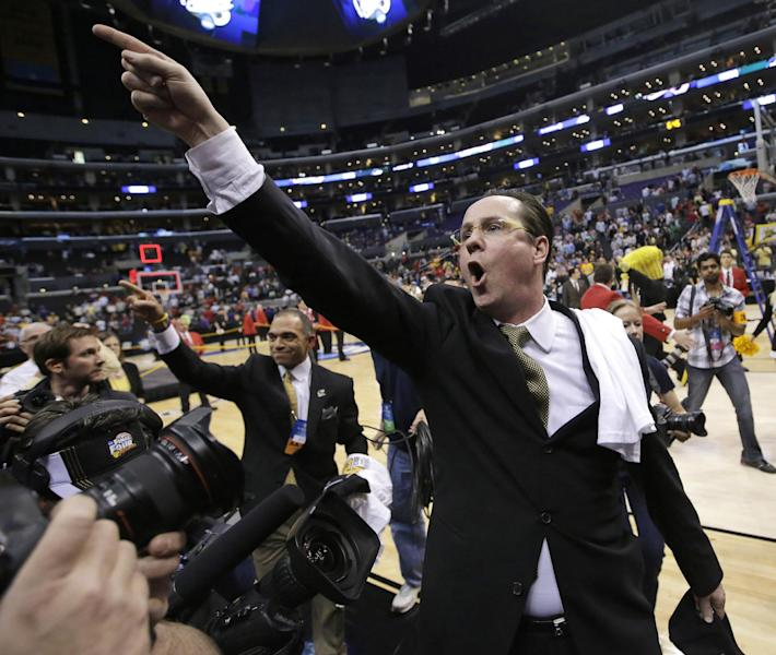 Wichita State coach Gregg Marshall points as he walks off the court after Wichita State defeated Ohio State 70-66 in the West Regional final in the NCAA men's college basketball tournament, Saturday, March 30, 2013, in Los Angeles. (AP Photo/Jae C. Hong)