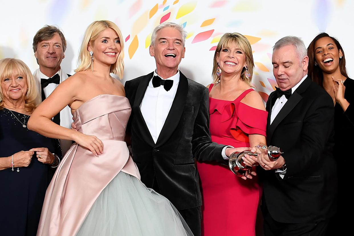 "Judy Finnigan, Richard Madeley, Holly Willoughby, Phillip Schofield Ruth Langsford, Eamonn Holmes, Rochelle Humes of ""This Morning"", pose in the winners room after winning the Live Magazine Show award during the National Television Awards 2020. (Photo by Gareth Cattermole/Getty Images)"