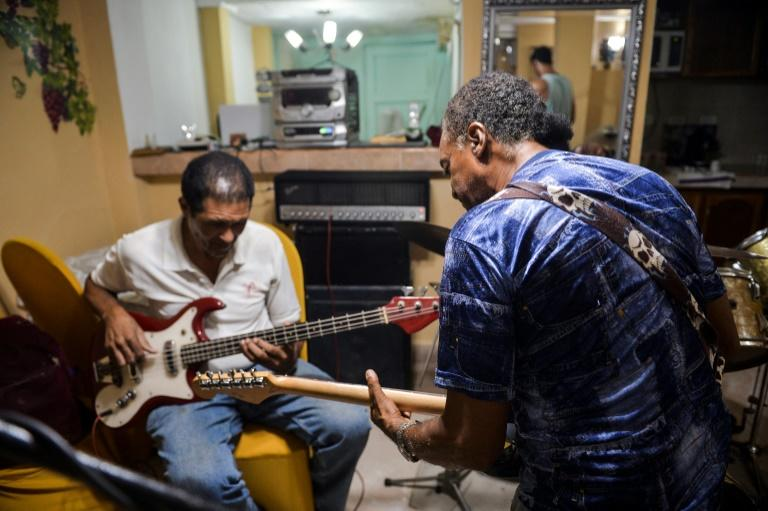The band Challenger rehearses in the Cuban capital; during the revolution, at a time when rock music was banned from the airwaves, one member remembers making his own instruments (AFP Photo/YAMIL LAGE)