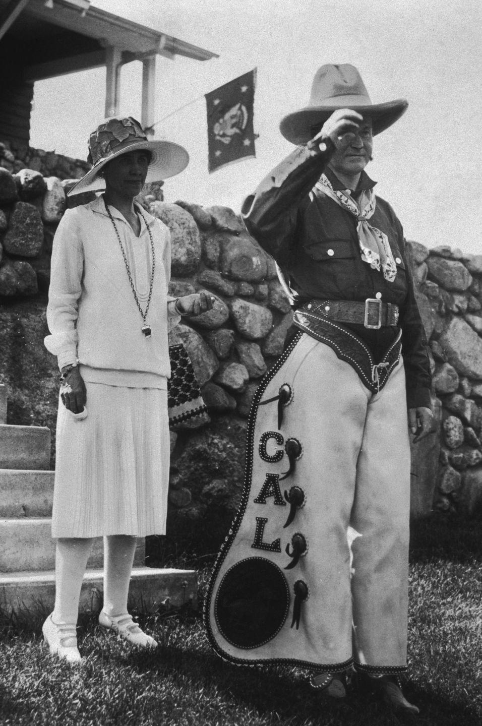 <p>Calvin Coolidge dons a cowboy outfit—complete with personalized chaps—for a 4th of July celebration in 1927.</p>