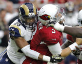 Arizona Cardinals quarterback Carson Palmer (3) is sacked by St. Louis Rams strong safety T.J. McDonald (25) during the first half of an NFL football game, Sunday, Nov. 9, 2014, in Glendale, Ariz. (AP Photo/Rick Scuteri)