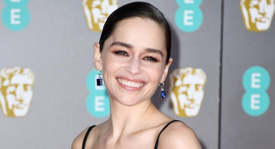 Emilia Clarke's 90s-inspired beauty look at the 73rd British Academy Film Awards. [Photo: Getty]