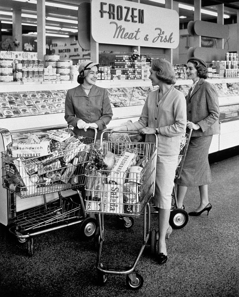 <p>A group of women share a laugh near the frozen foods section. </p>