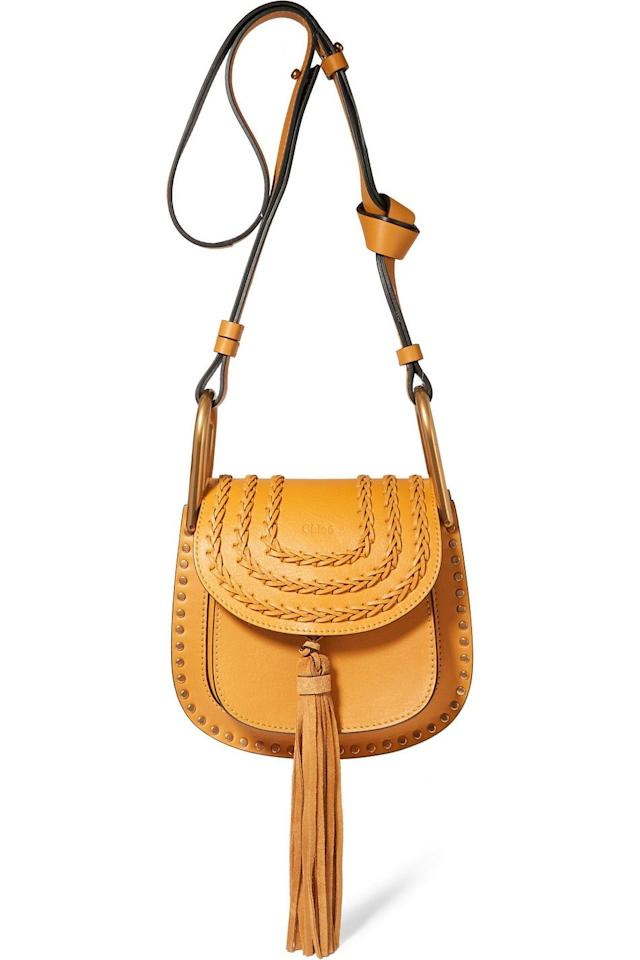 """<p>Hudson Mini Shoulder Bag</p><p><em>theoutnet.com</em></p><p>$498</p><p><a class=""""body-btn-link"""" href=""""https://go.redirectingat.com?id=74968X1596630&url=https%3A%2F%2Fwww.theoutnet.com%2Fen-us%2Fshop%2Fproduct%2Fchloe%2Fshoulder-bag%2Fshoulder-bags%2Fhudson-mini-tasseled-studded-leather-shoulder-bag%2F4772211931885816&sref=https%3A%2F%2Fwww.elle.com%2Ffashion%2Fshopping%2Fg31209857%2Four-top-picks-from-the-outnets-sale-will-make-your-day%2F"""" target=""""_blank"""">SHOP NOW</a></p>"""