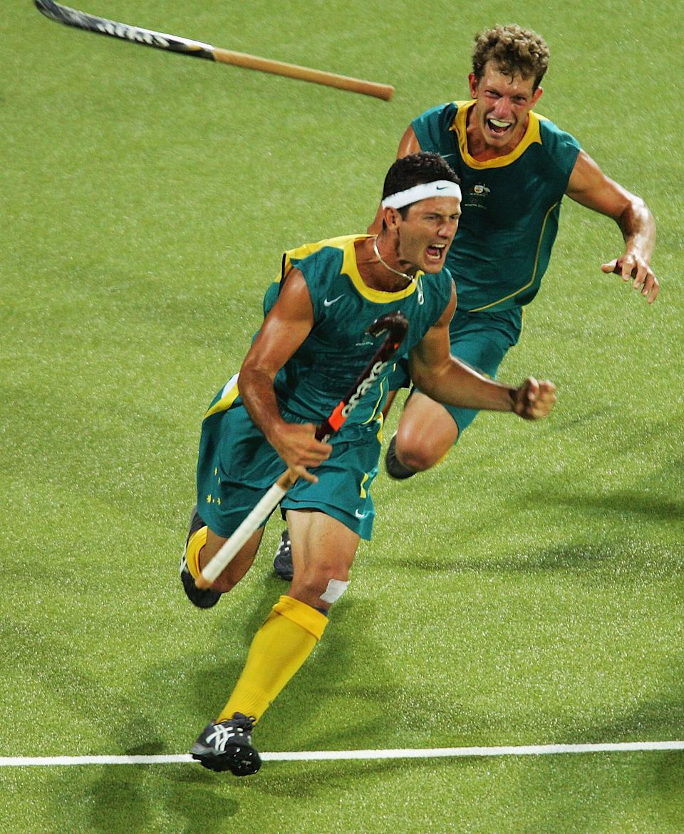 ATHENS - AUGUST 27: Jamie Dwyer #1 of Australia celebrates after scoring the winning goal in men's field hockey gold medal match against the Netherlands on August 27, 2004 during the Athens 2004 Summer Olympic Games at the Helliniko Olympic Complex Hockey Centre in Athens, Greece. (Photo by Stuart Franklin/Getty Images)