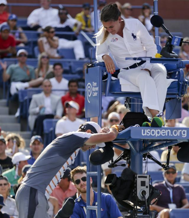 Tomas Berdych, of the Czech Republic, questions the chair umpires decision that a shot by Marin Cilic, of Croatia, bounced twice before hitting his racket during the quarterfinals of the 2014 U.S. Open tennis tournament, Thursday, Sept. 4, 2014, in New York. (AP Photo/Julio Cortez)