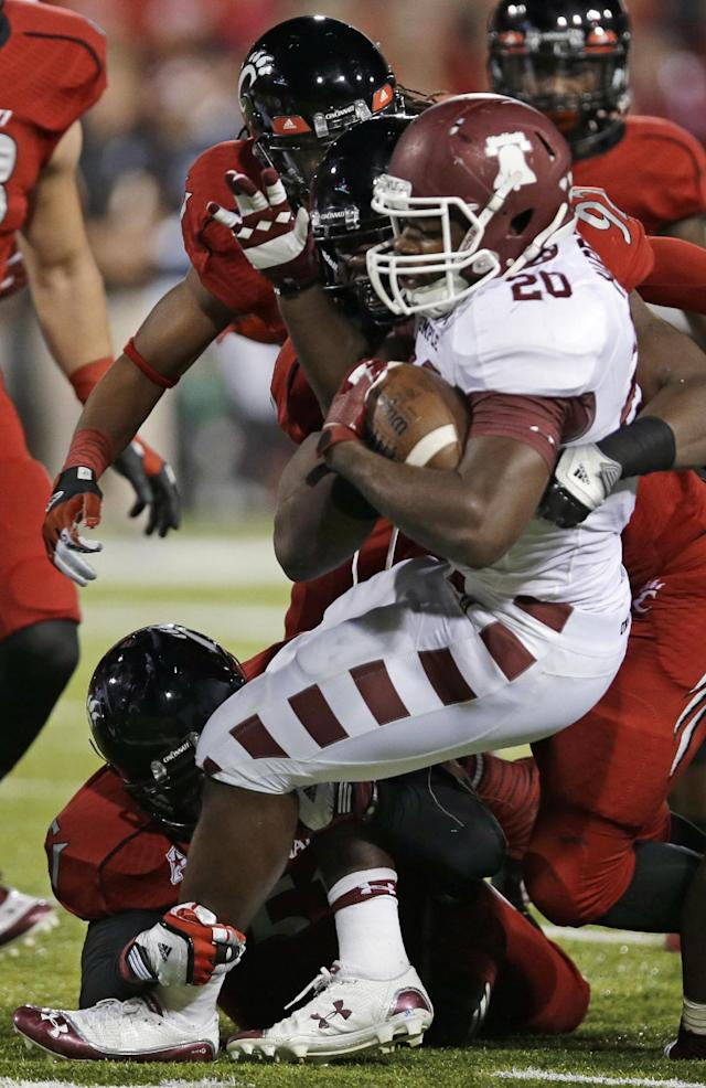 Temple running back Kenneth Harper (20) is stopped after a short gain in the first half of an NCAA college football game against Cincinnati, Friday, Oct. 11, 2013, in Cincinnati. (AP Photo/Al Behrman)