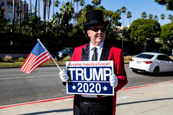 A Trump supporter waits for the arrival of President Trump in front of the Beverly Hills Hotel. (Photo: Etienne Laurent/Epa-Efe/Shutterstock)