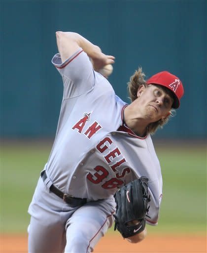 Los Angeles Angels starter Jered Weaver pitches in the first inning in a baseball game against the Cleveland Indians, Friday, April 27, 2012, in Cleveland. (AP Photo/Tony Dejak)