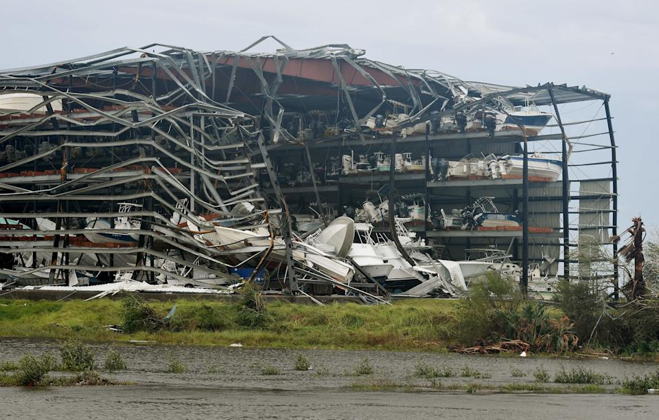 Damaged boats in a multi-level storage facility are seen in Rockport.