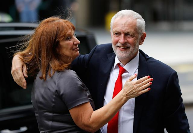<p>Britain's Labour party leader Jeremy Corbyn is greeted as he arrives at Labour party headquarters in London, Friday, June 9, 2017. (Photo: Frank Augstein/AP) </p>
