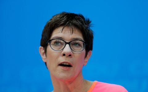 """In a move widely seen as anointing her chosen successor, Angela Merkel on Mondaypromoted one of her key lieutenants to a pivotal role as chairman of her Christian Democrat party (CDU). The appointment puts Annegret Kramp-Karrenbauer in pole position to take control of the party when Mrs Merkel eventually steps down or is forced from office. Popularly known as """"mini-Merkel"""", Ms Kramp-Karrenbauer has long been seen as the chancellor's preferred successor. But Monday's move is the first sign that Mrs Merkel is now actively planning for the succession even as rival candidates begin to circle. The appointment of the loyalist Ms Kramp-Karrenbauer was also a signal that Mrs Merkel does not intend to give any ground to her critics within the party amid rumblings of discontent over the concessions she made to secure a new coalition deal. """"We can rely on each other, even if we each have our own opinions,"""" Mrs Merkel said as she announced Ms Kramp-Karrenbauer's appointment. The governor of German Saarland state and designated CDU Secretary General, Annegret Kramp-Karrenbauer, addresses a news conference after a party's leaders meeting in Berlin, Germany, Monday, Feb. 19, 2018 Credit: AP The decision to make her party chairman has particular resonance because it was from the same office that Mrs Merkel launched her own successful bid to become CDU leader 18 years ago. Mrs Merkel had to fill the position after the current party chairman, Peter Tauber, announced he was stepping down because of ill health. But she said it was Ms Kramp-Karrenbauer who came to her and suggested the move. """"I was impressed by the idea,"""" Mrs Merkel added. Although Ms Kramp-Karrenbauer has a formidable record as an election campaigner, all her experience so far has been in regional politics in her home state of Saarland, where she is currently prime minister. Mrs Merkel has been thought to want to give her protege a national role for some time in order to increase her profile. But with the CDU reduced t"""