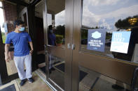 Usage of required face masks are posted throughout Jackson State University during an open COVID-19 vaccination site sponsored by the university and the Jackson-Hinds Comprehensive Health Center in Jackson, Miss., Tuesday, Aug. 3, 2021. (AP Photo/Rogelio V. Solis)