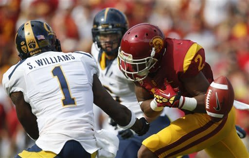 California defensive back Steve Williams, left, breaks up a pass intended for Southern California wide receiver Robert Woods during the first half of an NCAA college football game in Los Angeles, Saturday, Sept. 22, 2012. (AP Photo/Jae C. Hong)