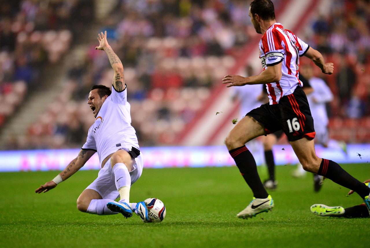 Sunderlands Ki Sung Yueng (not pictured) fouls Peterborough's Lee Tomlin during the Capital One Cup, Third round match at the Stadium of Light, Sunderland.