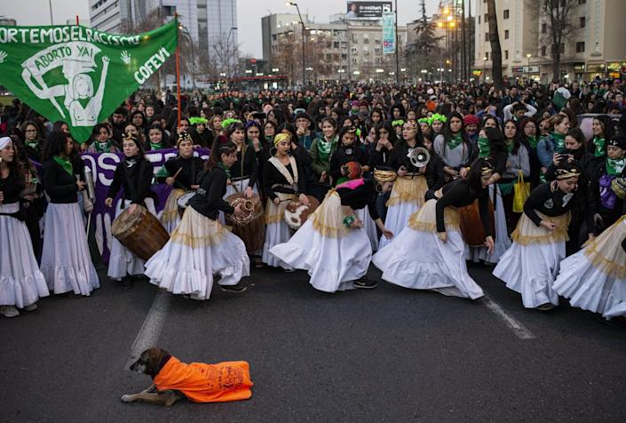 Women dance during a march in favor feminist movements