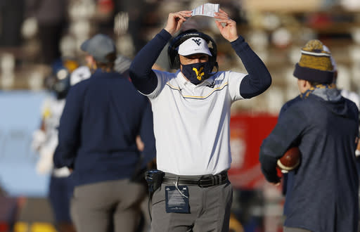 West Virginia head coach Neal Brown reacts after his team was stoped shot of a first down during the first half of an NCAA college football game against Iowa State, Saturday, Dec. 5, 2020, in Ames, Iowa. (AP Photo/Matthew Putney)