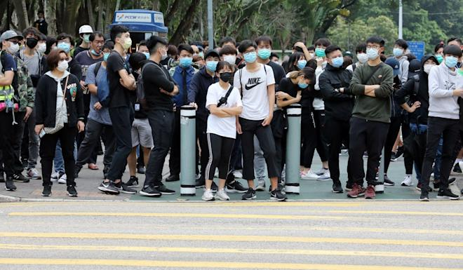 While a planned rally against the use of a Tai Po clinic for suspected Covid-19 patients was called off, a crowd of about 50 people gathered anyway. Photo: Dickson Lee