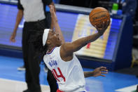 Los Angeles Clippers guard Terance Mann (14) shoots in the second half of an NBA basketball game against the Oklahoma City Thunder, Sunday, May 16, 2021, in Oklahoma City. (AP Photo/Sue Ogrocki)