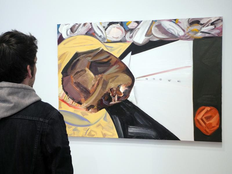 A visitor looks at the painting 'Open Casket' by artist Dana Schutz in the Whitney Museum of American Art in New York, USA, 29 March 2017. The artwork inspired by a photo of the Afro-American Emmett Till who was murdered in Mississippi in 1955 has caused controversy in the world of art. Photo: Johannes Schmitt-Tegge/dpa | usage worldwide (Photo by Johannes Schmitt-Tegge/picture alliance via Getty Images)