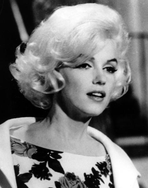 "FILE - In this April 1962 file photo, actress Marilyn Monroe is shown on the set of her last movie, ""Something's Got To Give,"" in Los Angeles. Fifty years have not dimmed skeptics' suspicions about the death of Marilyn Monroe, but the intervening decades have seen technological leaps that could alter the investigation were it to occur today. (AP Photo, file)"